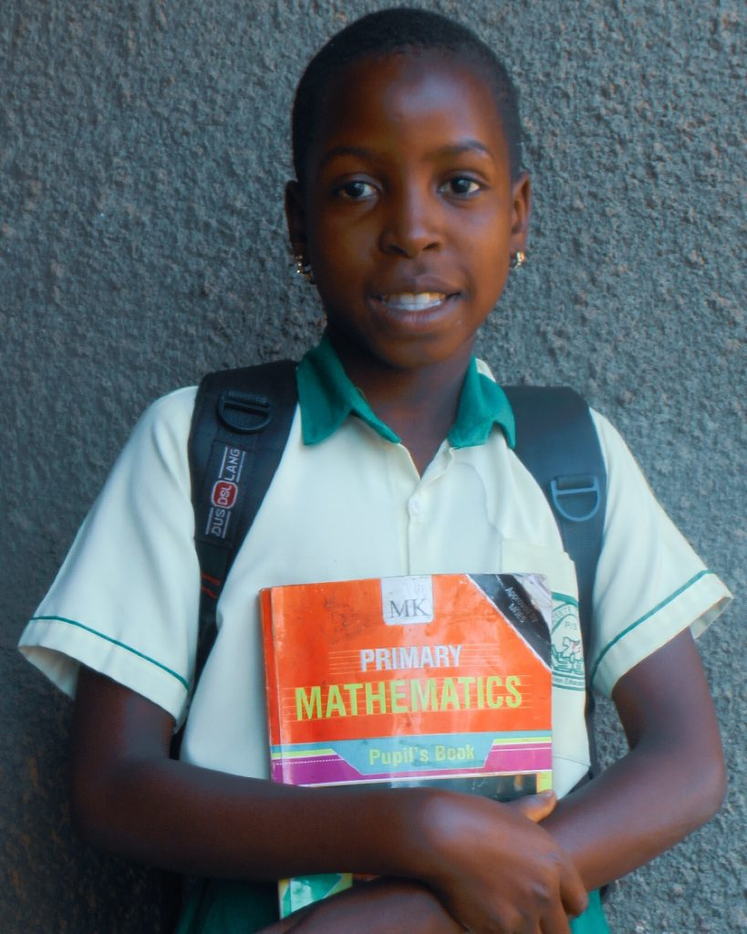 one of our beneficiaries. At Cosma we get children from vulnerable homes and give them an opportunity to go to school.
